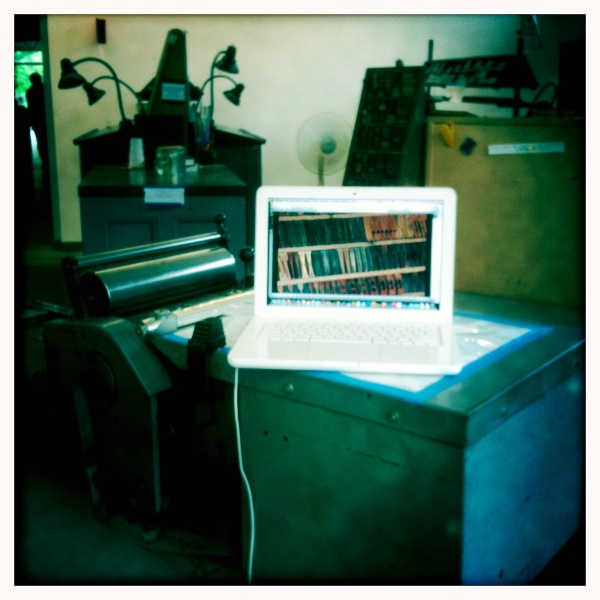 The film Typeface playing on a laptop on a Vandercook press, taken on an iPhone